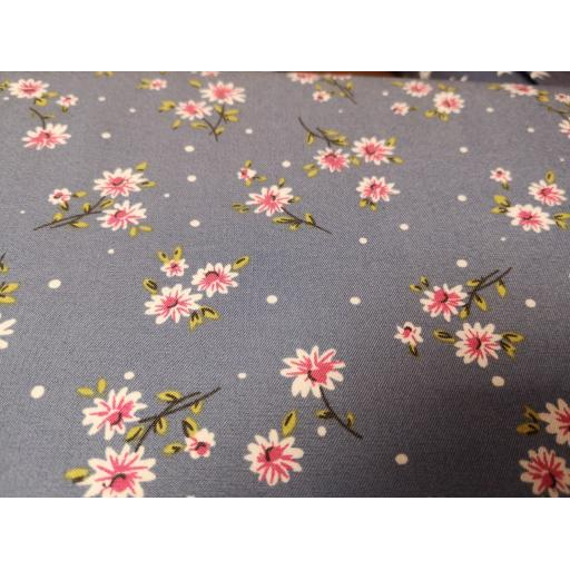 Floral Printed denim fabric with pink flowers,
