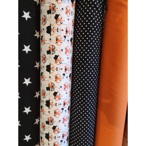 Foxes in glasses, black stars, black spots, orange poplin.jpg