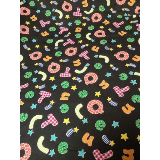 Black alphabet cotton with bright letters fabric.jpg