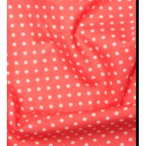 Salmon pink spot cotton poplin
